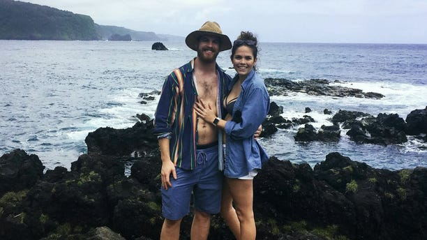 """The couple actually got engaged on a""""snuba"""" trip, which differs from scuba, in that divers wear an oxygen line that's connected to the shipinstead of a tank on their back."""