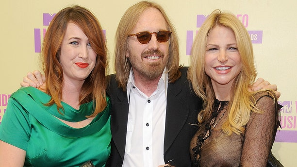Tom Petty, daughter Adria Petty and wife Dana Petty attend the 2012 MTV Video Awards. Petty died in October 2017 and his wife and daughter have reportedly been at odds over the late Heartbreaker's legacy.