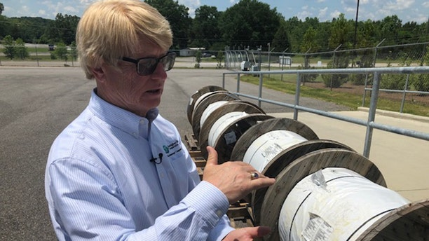 Steve Foshee, Ceo of Tombigbee, shows of the fiber optic reels the co-ops subsidiary will run in northwest Alabama. (Fox News/Charles Watson)