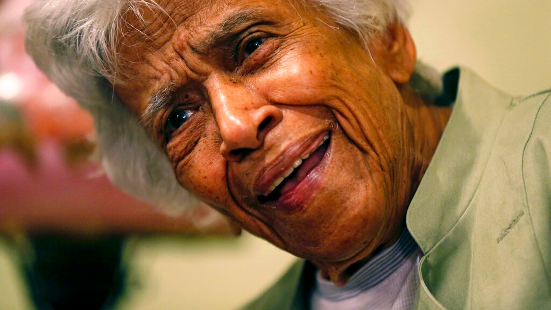 Leah Chase speaks at her family's restaurant, Dooky Chase's Restaurant, in New Orleans in 2015. The legendary chef and civil rights icon has died at 96, according to a statement her family released to news outlets. (AP Photo/Gerald Herbert, File)