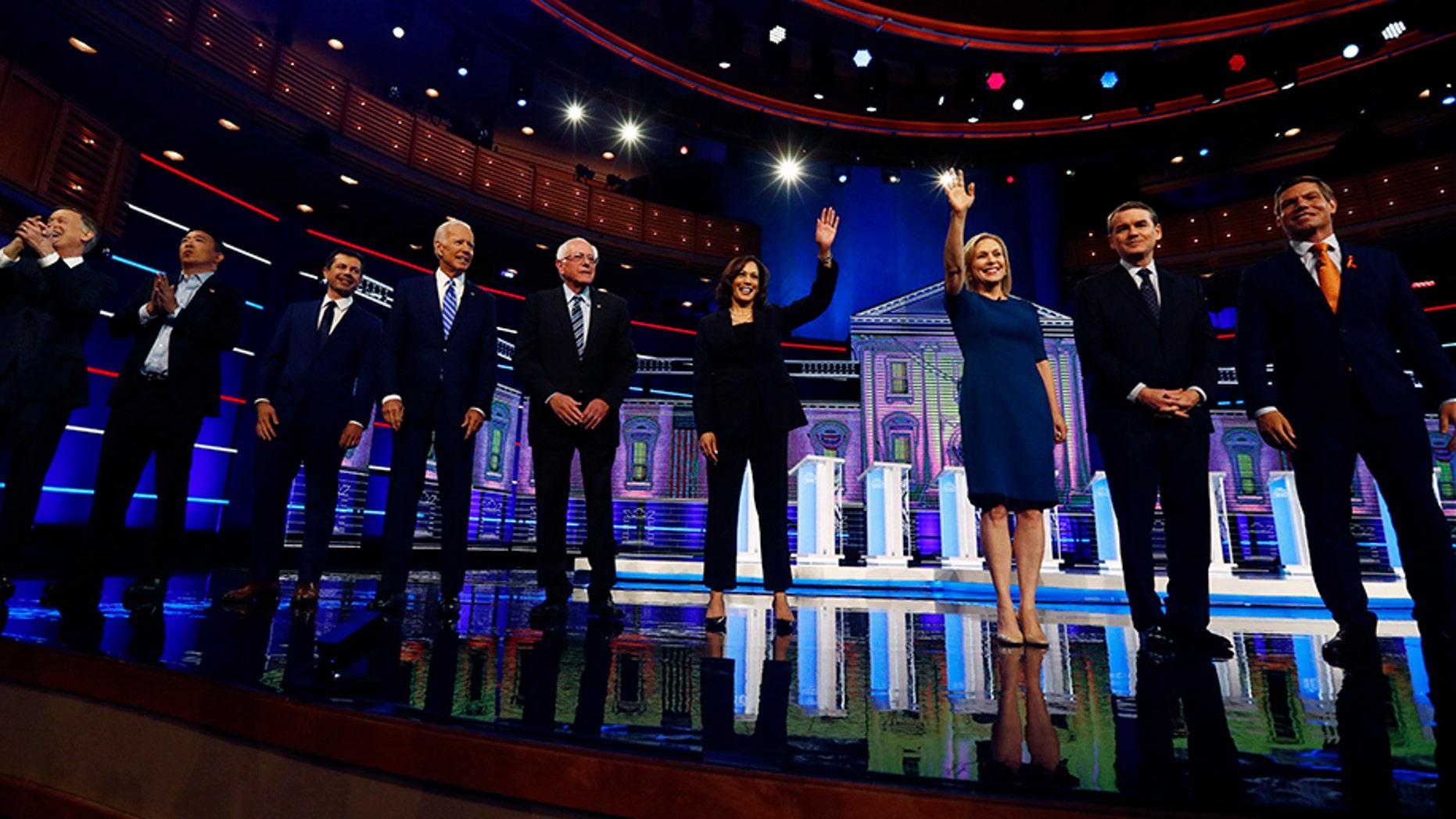 Democratic presidential candidates, from left, former Colorado Gov. John Hickenlooper, entrepreneur Andrew Yang, South Bend, Ind., Mayor Pete Buttigieg, former Vice-President Joe Biden, Sen. Bernie Sanders, I-Vt., Sen. Kamala Harris, D-Calif., Sen. Kristen Gillibrand, D-N.Y., former Colorado Sen. Michael Bennet and Rep. Eric Swalwell, D-Calif., assembled in Miami last months. (AP Photo/Brynn Anderson)