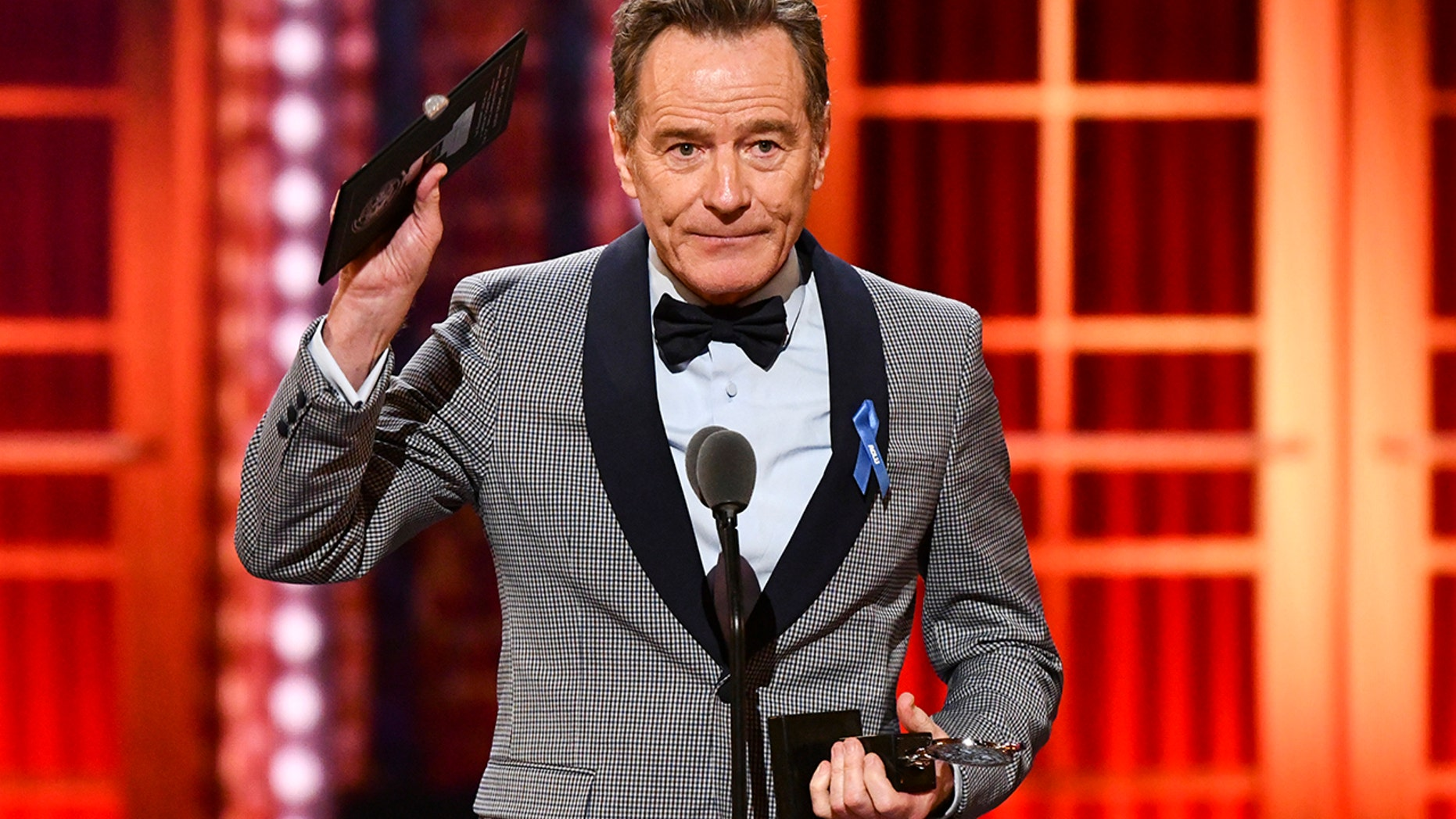 "Bryan Cranston accepts the award for best performance by an actor in a leading role in a play for ""Network"" at the 73rd annual Tony Awards at Radio City Music Hall on Sunday, June 9, 2019, in New York. (Photo by Charles Sykes/Invision/AP)"