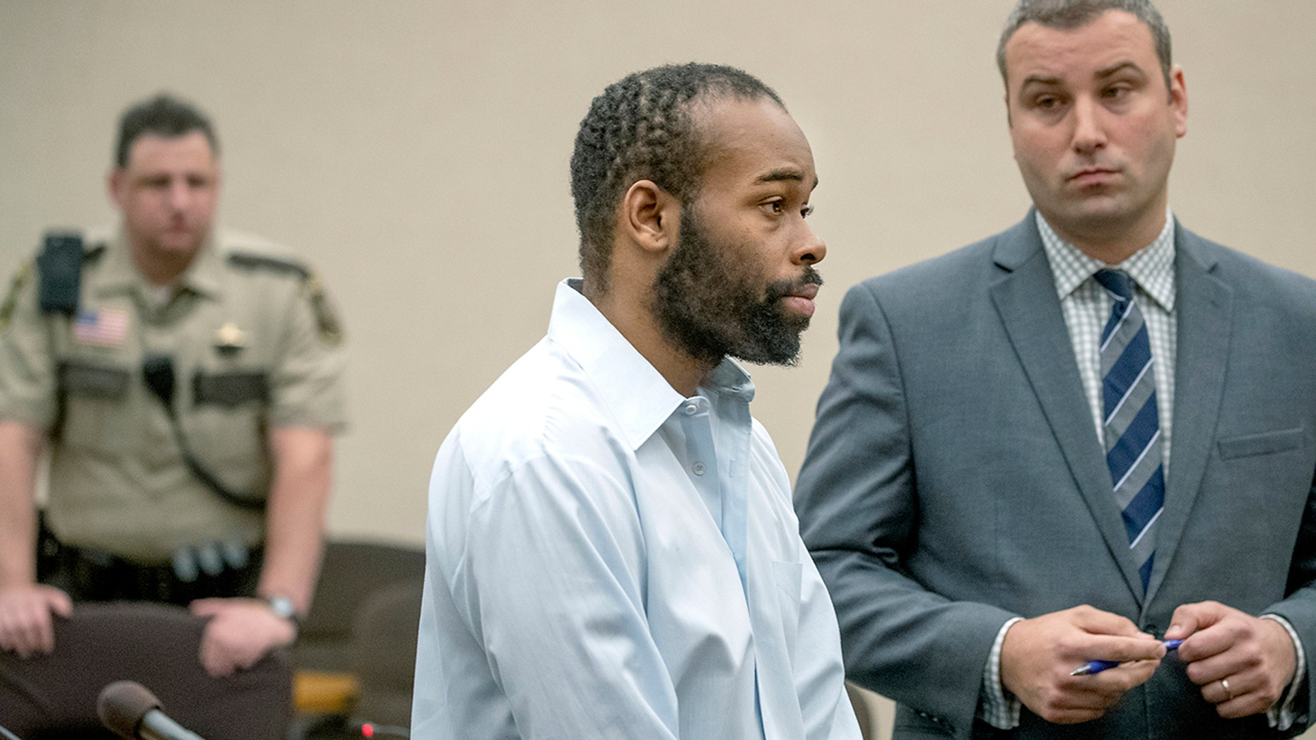 Emmanuel Aranda, who threw a 5-year-old boy over a Mall of America balcony, and his lawyer Paul Sellers, right, listen as Judge Jeannice Reding hands out a 19-year sentence at the Hennepin County Government Center, Monday, in Minneapolis. (Elizabeth Flores/Star Tribune via AP)