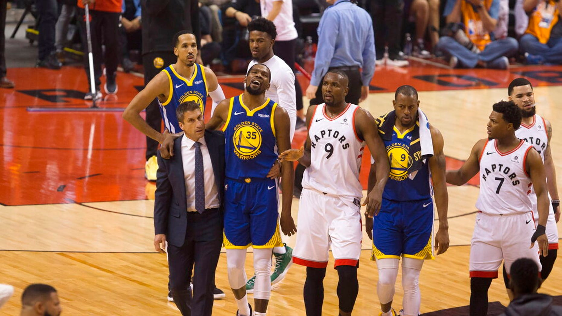 Golden State Warriors forward Kevin Durant (35) walks off the court after sustaining an injury.
