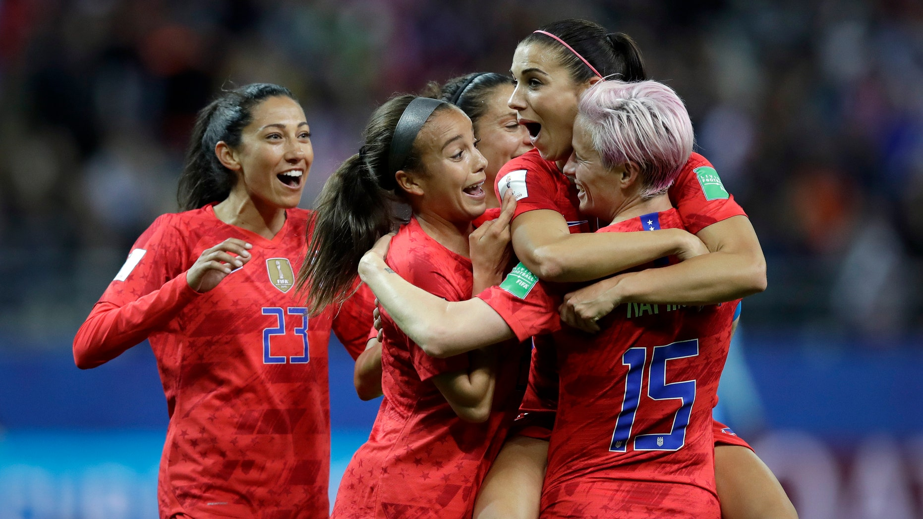 United States' Alex Morgan, second right, celebrates after scoring her side's 12th goal during the Women's World Cup Group F soccer match between United States and Thailand at the Stade Auguste-Delaune in Reims, France, Tuesday, June 11, 2019. Morgan scored five goals during the match. (AP Photo/Alessandra Tarantino)
