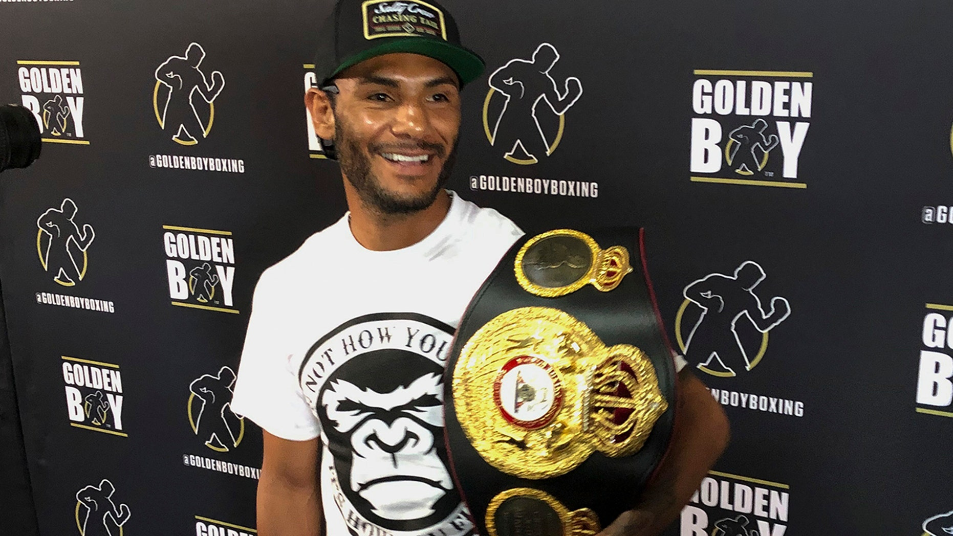 In this Tuesday, June 18, 2019 photo, WBA super featherweight champion Andrew Cancio speaks to reporters at the Westside Boxing Club in Los Angeles. Cancio is a boxing champion who also works for the Southern California Gas Company, and he plans to keep his day job even after his lucrative rematch with Alberto Machado in Indio, Calif. (AP Photo/Greg Beacham)