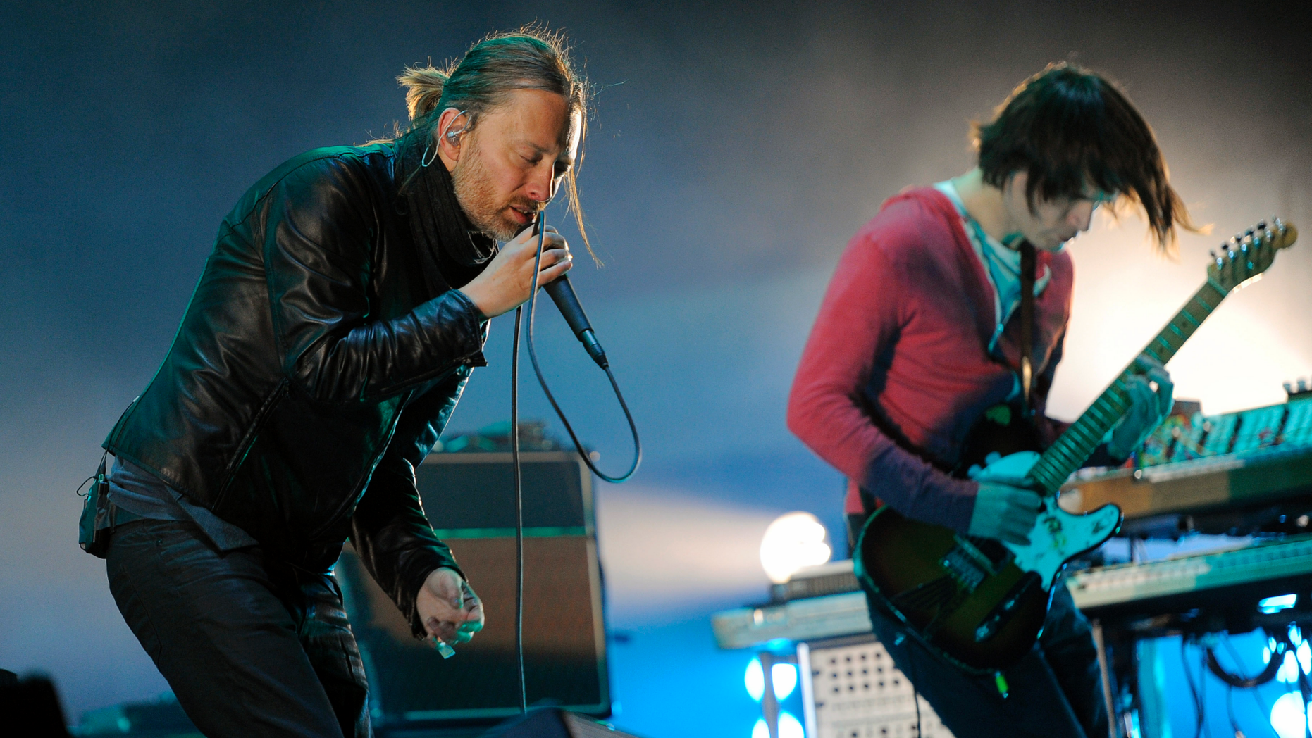 FILE - In this April 14, 2012 file photo, Thom Yorke, left, and Jonny Greenwood of Radiohead perform during the band's headlining set at the 2012 Coachella Valley Music and Arts Festival in Indio, Calif.  Radiohead says a trove of unreleased music has been stolen and is being used for ransom, but instead of paying up, the band announced Tuesday June 11, 2019, they will release it in aid of environmental activist group Extinction Rebellion.(AP Photo/Chris Pizzello, File)