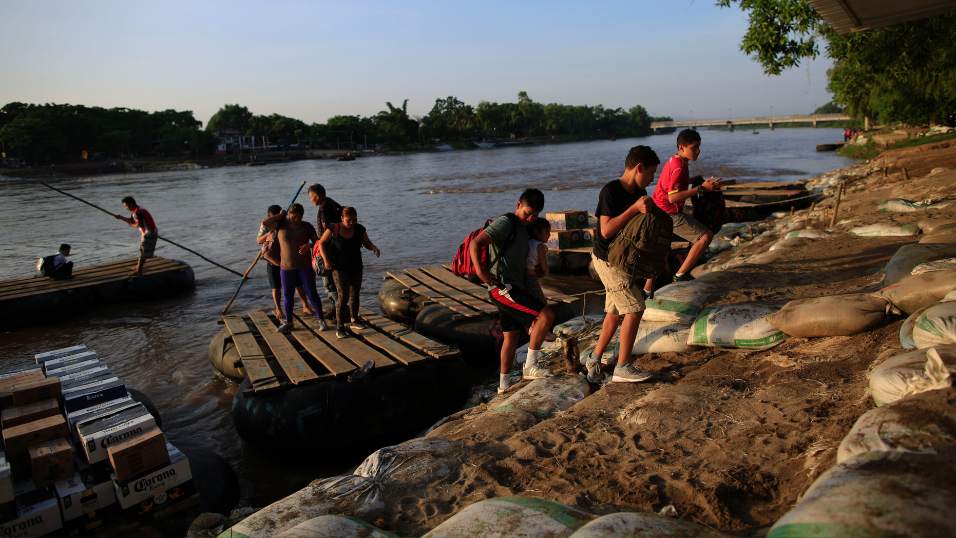A group of migrants arriving from Guatemala disembark from a raft in Ciudad Hidalgo, Mexico, Tuesday, June 18, 2019. The number of migrants taking rafts at the busy Ciudad Hidalgo crossing point appears to have decreased significantly in recent days amid fears of a pending deployment of the National Guard along the southern border. (AP Photo/Rebecca Blackwell)