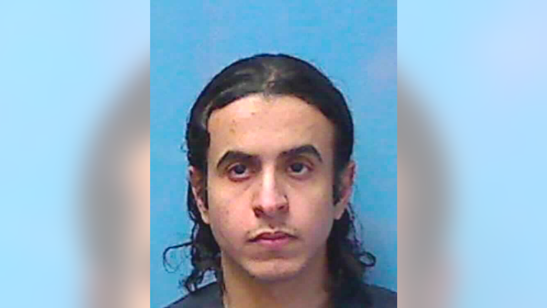 This undated photo provided by the Nevada Department of Corrections shows Mazen Alotaibi, 30, of Saudi Arabia. A Nevada judge is being asked for a sentencing do-over for Alotaibi, a former Saudi Arabian air force sergeant serving 35 years in prison for kidnapping and sexually assaulting a 13-year-old boy at a Las Vegas Strip hotel on New Year's Eve 2012. (Nevada Department of Corrections via AP)
