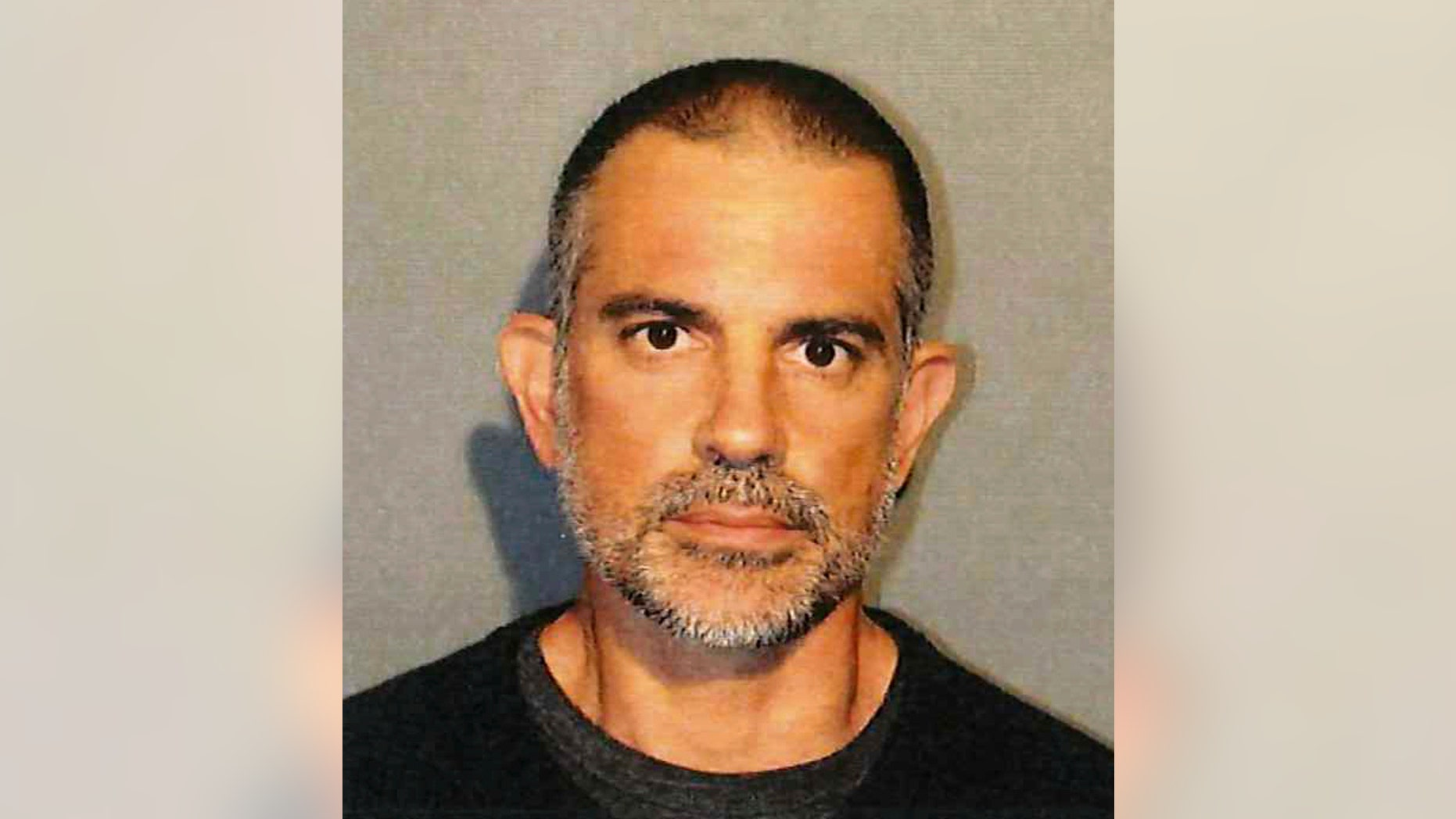 This photo provided by the New Canaan Police Department shows Fotis Dulos. Police in Connecticut have arrested a missing mother of five's estranged husband and his girlfriend on charges of evidence tampering and hindering prosecution. New Canaan authorities announced Sunday, June 2, 2019, the arrests of 51-year-old Dulos and 44-year-old Michelle C. Troconis. Both were detained on $500,000 bail and are scheduled to be arraigned Monday in Norwalk Superior Court. Details of the allegations were not released. (New Canaan Police Department via AP)