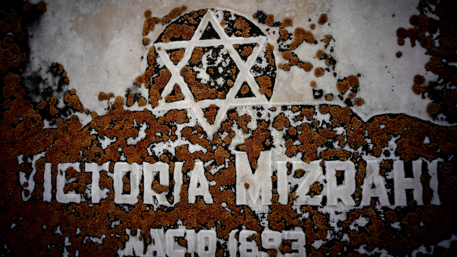 The Star of David decorates a tomb buried by moss at the Jewish cemetery in Guanabacoa in eastern Havana, Cuba, June 7, 2019. Slowly, the first Jewish cemetery in Cuba begins to be rehabilitated along with the memory of many of the island's early Jewish ancestors. (AP Photo / Ramon Espinosa)