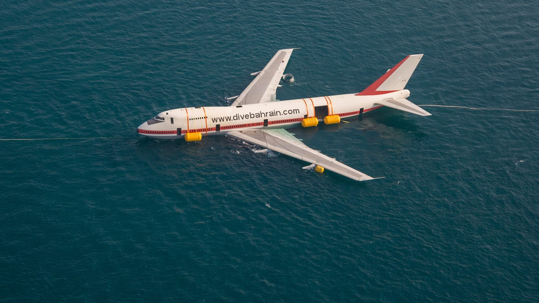 The Boeing 747 was towed out to sea to be sunk as part of what's being called an eco-friendly project.