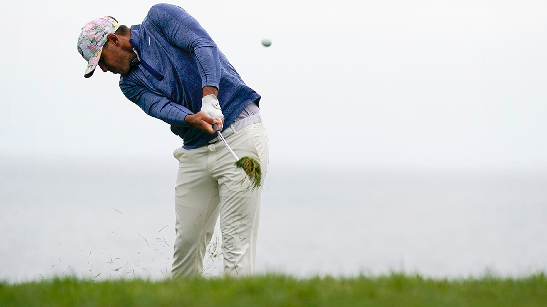 Brooks Koepka hits from the rough on the 11th hole during the first round of the U.S. Open Championship golf tournament Thursday, June 13, 2019, in Pebble Beach, Calif. (AP Photo/David J. Phillip)