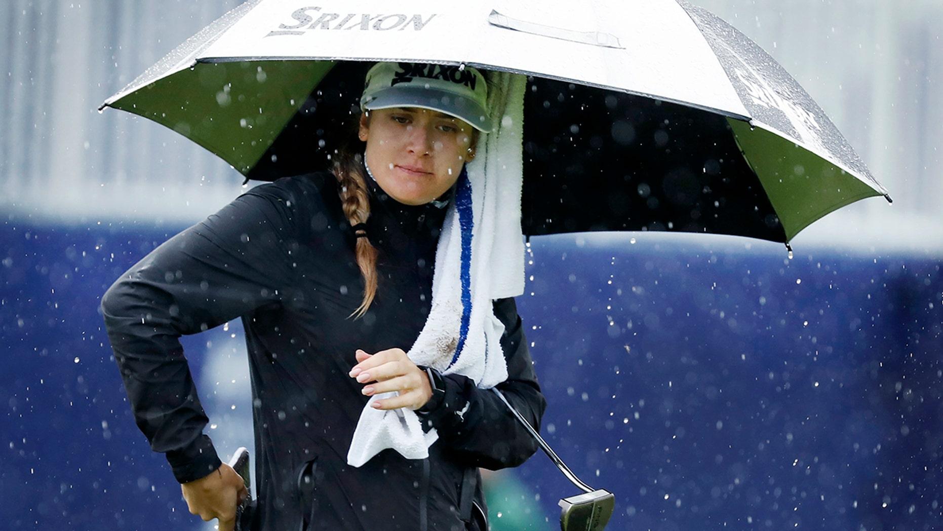 Hannah Green, of Australia, walks on the 18th green during the first round of the KPMG Women's PGA Championship golf tournament Thursday, June 20, 2019, in Chaska, Minn. (AP Photo/Charlie Neibergall)