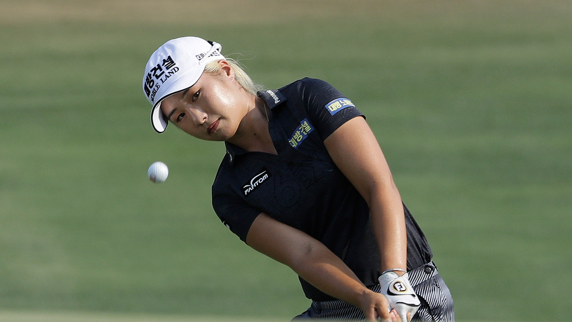 FILE - In this June 2, 2019, file photo, Jeongeun Lee6, of South Korea, chips to the 16th green during the final round of the U.S. Women's Open golf tournament, in Charleston, S.C. (AP Photo/Steve Helber, File)