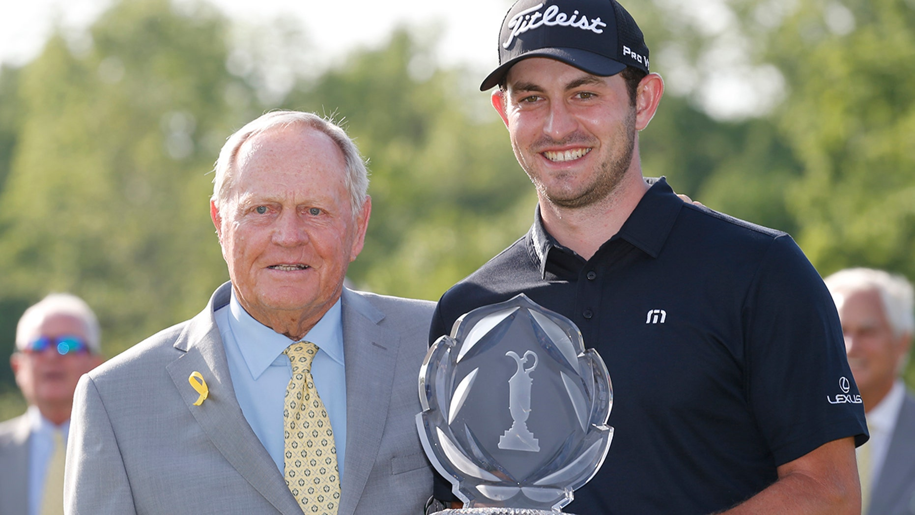 Jack Nicklaus, left, presents Patrick Cantlay with the trophy after Cantlay won the Memorial golf tournament Sunday, June 2, 2019, in Dublin, Ohio. (AP Photo/Jay LaPrete)