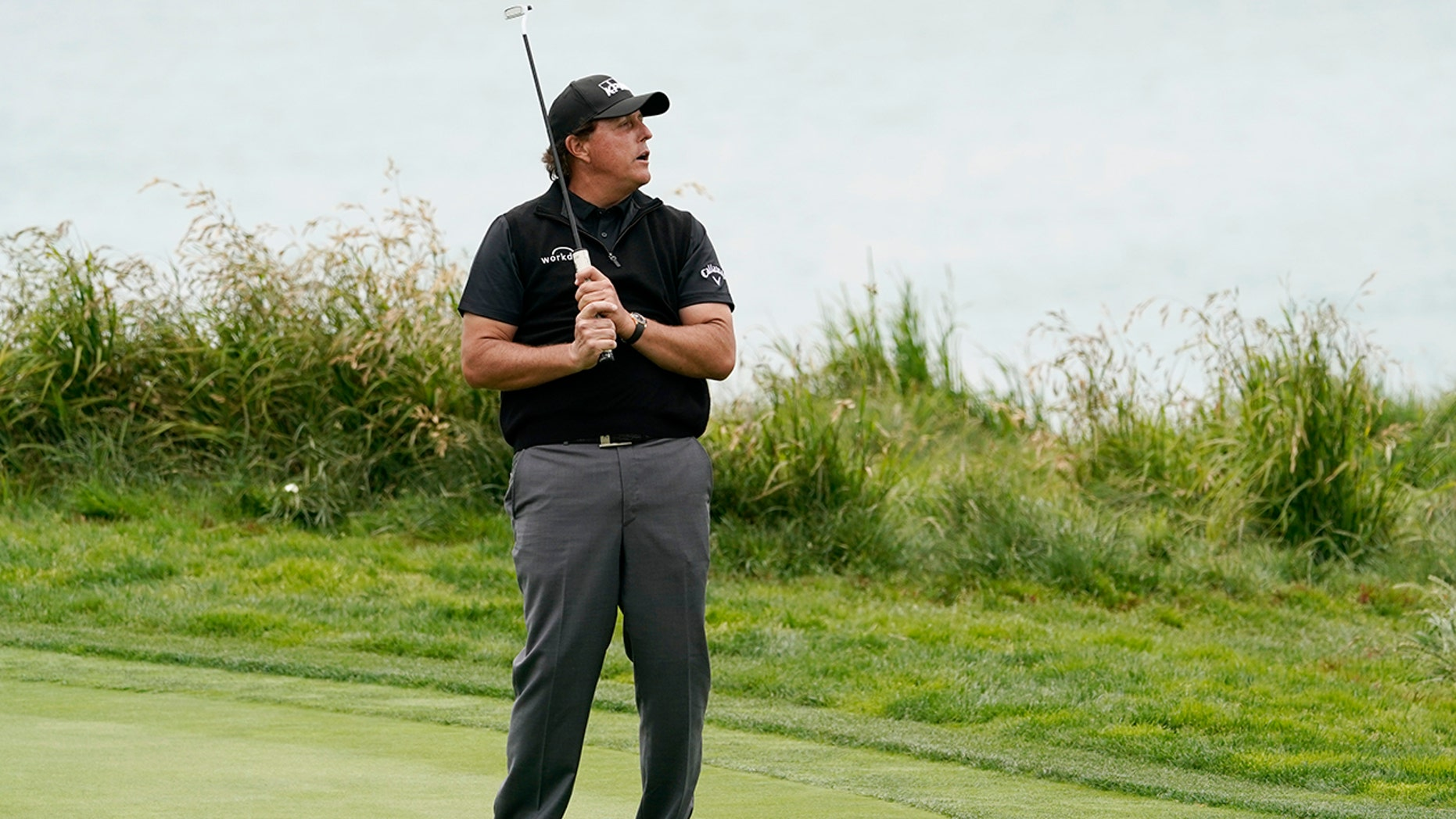 Phil Mickelson reacts after missing a putt on the ninth hole during the first round of the U.S. Open Championship golf tournament Thursday, June 13, 2019, in Pebble Beach, Calif. (AP Photo/David J. Phillip)