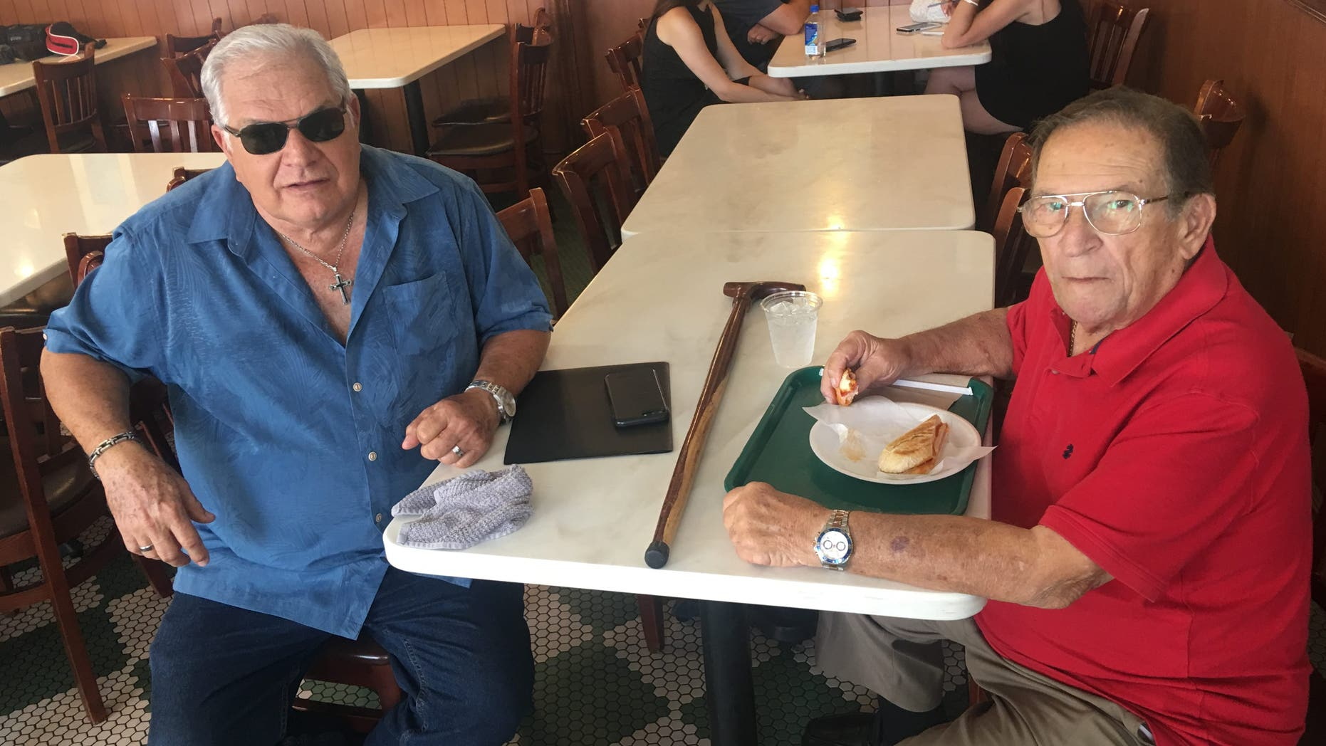 "Emilio Izquierdo, 71, and Gonzalo Lopez, 83, have lunch at Little Havana staple Versailles. Socialism, Izquierdo fears, will ""destroy America."" (Alex Pappas/Fox News)."