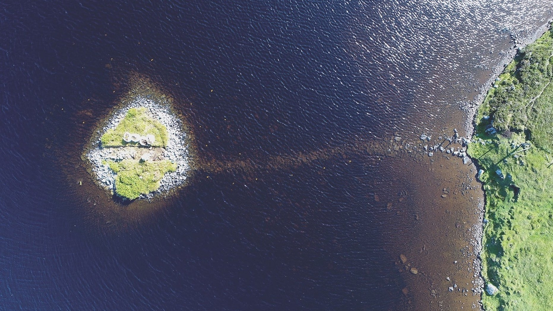 A bird's-eye view of Loch Bhorgastail, an islet that was clearly human-made with boulders.