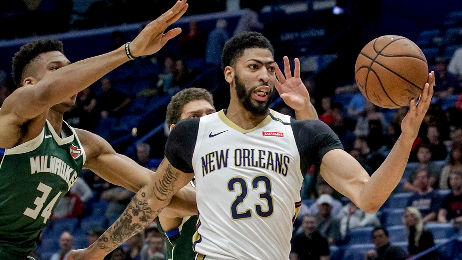 In this March 12 photo, New Orleans Pelicans forward Anthony Davis (23) takes an outlet pass against Milwaukee Bucks forward Giannis Antetokounmpo (34) in the first half of a game in New Orleans. (AP Photo/Scott Threlkeld, File)