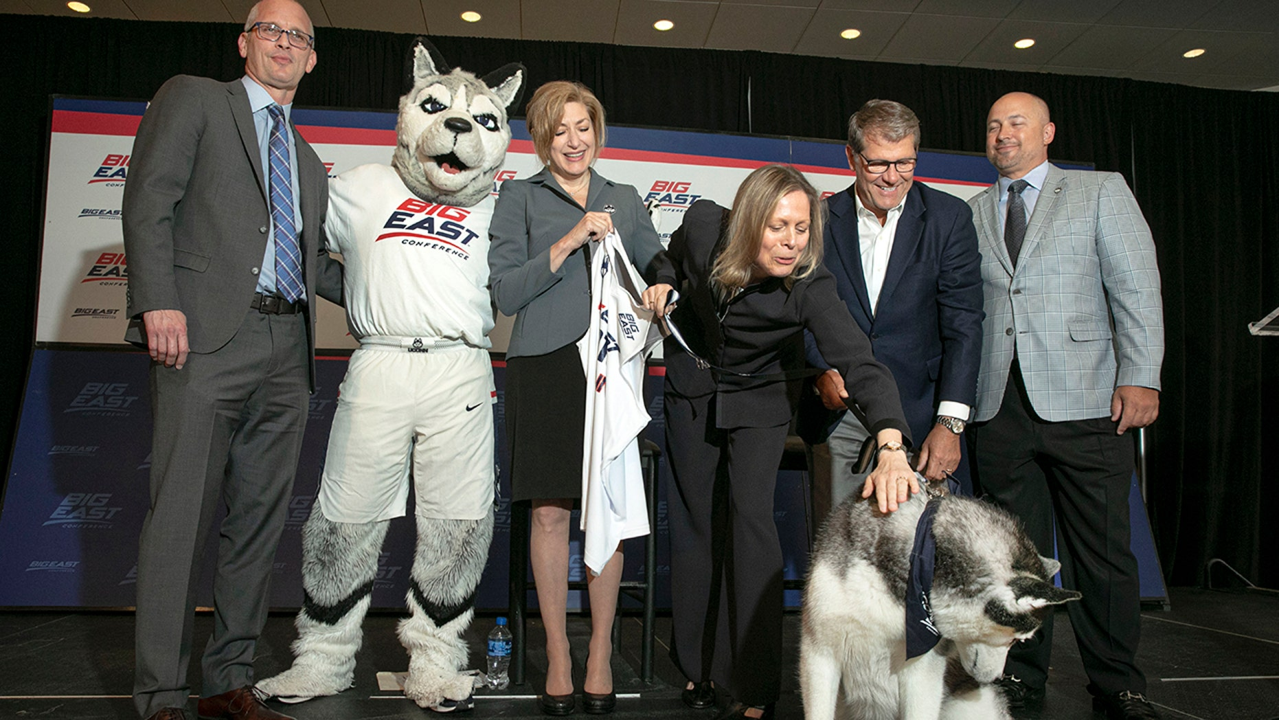 University of Connecticut men's basketball coach Dan Hurley, left, University President Susan Herbst, third left, Big East Commissioner Val Ackerman, fourth left, women's basketball coach Geno Auriemma, fifth left, and Director of Athletics David Benedict, pose for photos during the announcement that the University of Connecticut is re-joining the Big East Conference, at New York's Madison Square Garden, Thursday, June 27, 2019. (AP Photo/Richard Drew)
