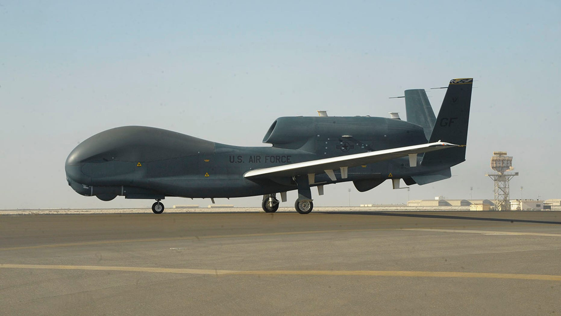 The US Air Force photograph of a RQ-4 Global Hawk can be seen on the tarmac at Al-Dhafra Air Base near Abu Dhabi, United Arab Emirates. Blake Browning / US Air Force (AP) [AP]