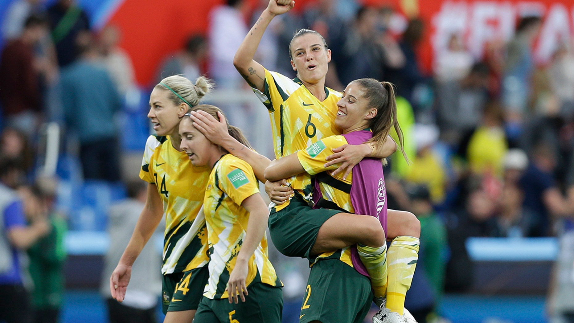 Australia's Chloe Logarzo, top, celebrates with a teammate at the end of the Women's World Cup Group C soccer match between Australia and Brazil at Stade de la Mosson in Montpellier, France, Thursday, June 13, 2019. Australia defeated Brazil 3-2. (AP Photo/Claude Paris)