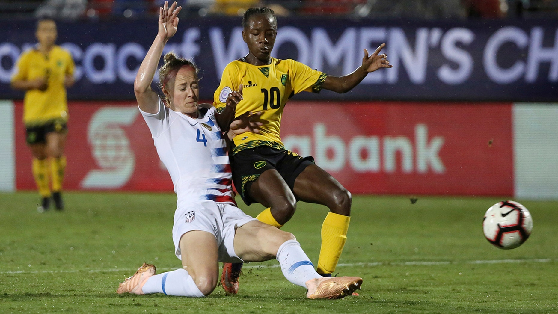 FILE - In this Oct. 14, 2018, file photo, United States defender Becky Sauerbrunn, left, defends against Jamaica forward Jody Brown during the second half of a CONCACAF women's World Cup qualifying tournament soccer match in Frisco, Texas. (AP Photo/Andy Jacobsohn, File)