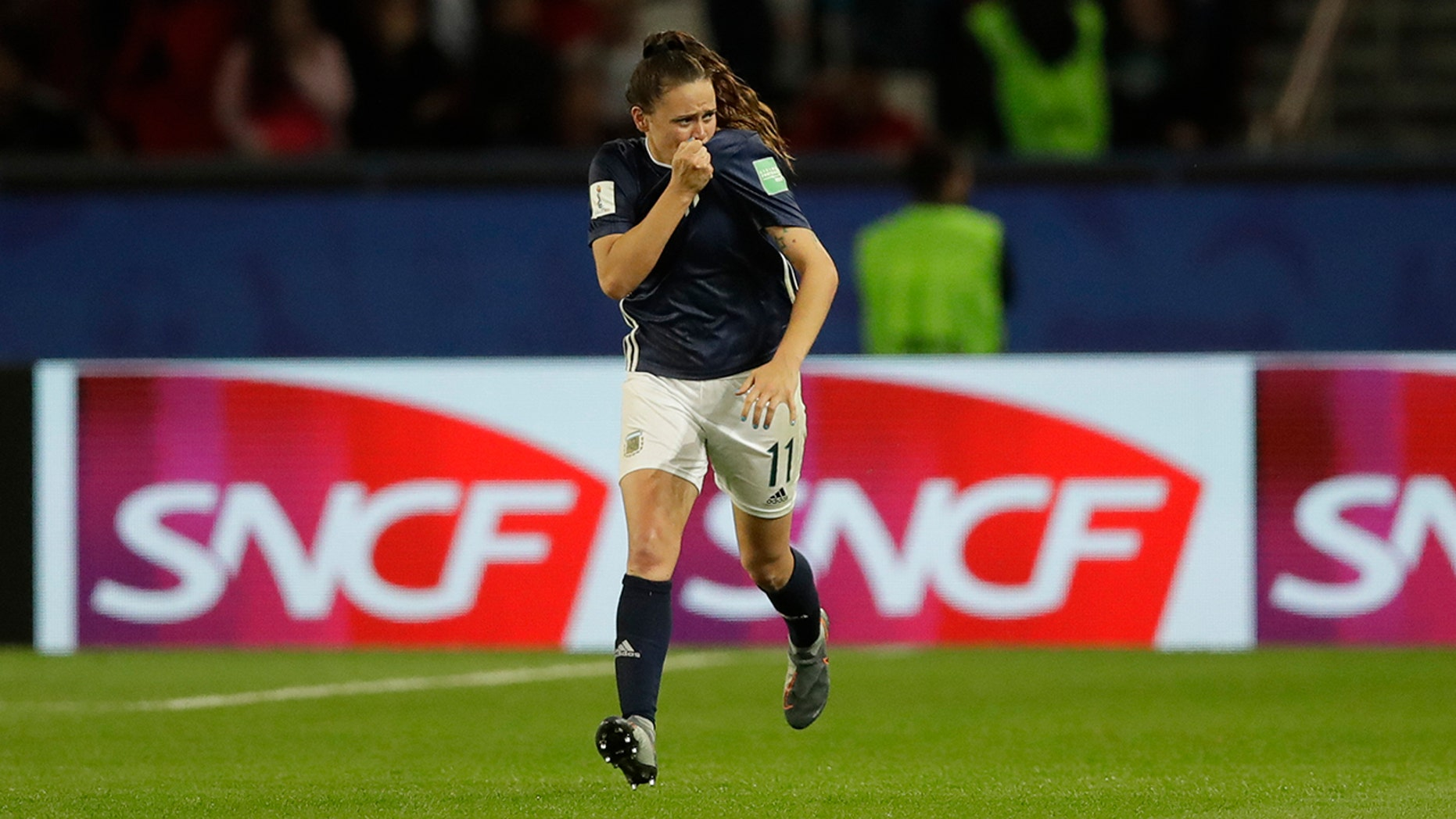 Argentina's Florencia Bonsegundo celebrates after scoring an equaliser goal during the Women's World Cup Group D soccer match between Scotland and Argentina at Parc des Princes in Paris, France, Wednesday, June 19, 2019. Bonsegundo scored in the extra time and the match ended in a 3-3 draw. (AP Photo/Alessandra Tarantino)