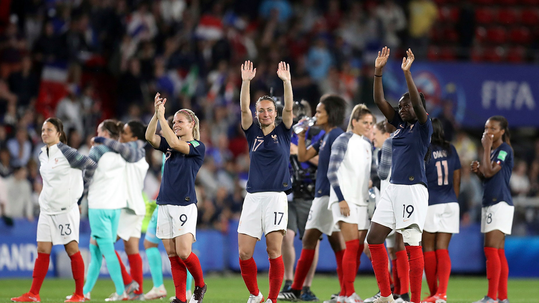 France players celebrate at the end of the Women's World Cup Group A soccer match between Nigeria and France at the Roazhon Park in Rennes, France, Monday, June 17, 2019. France beat Nigeria 1-0. (AP Photo/Vincent Michel)