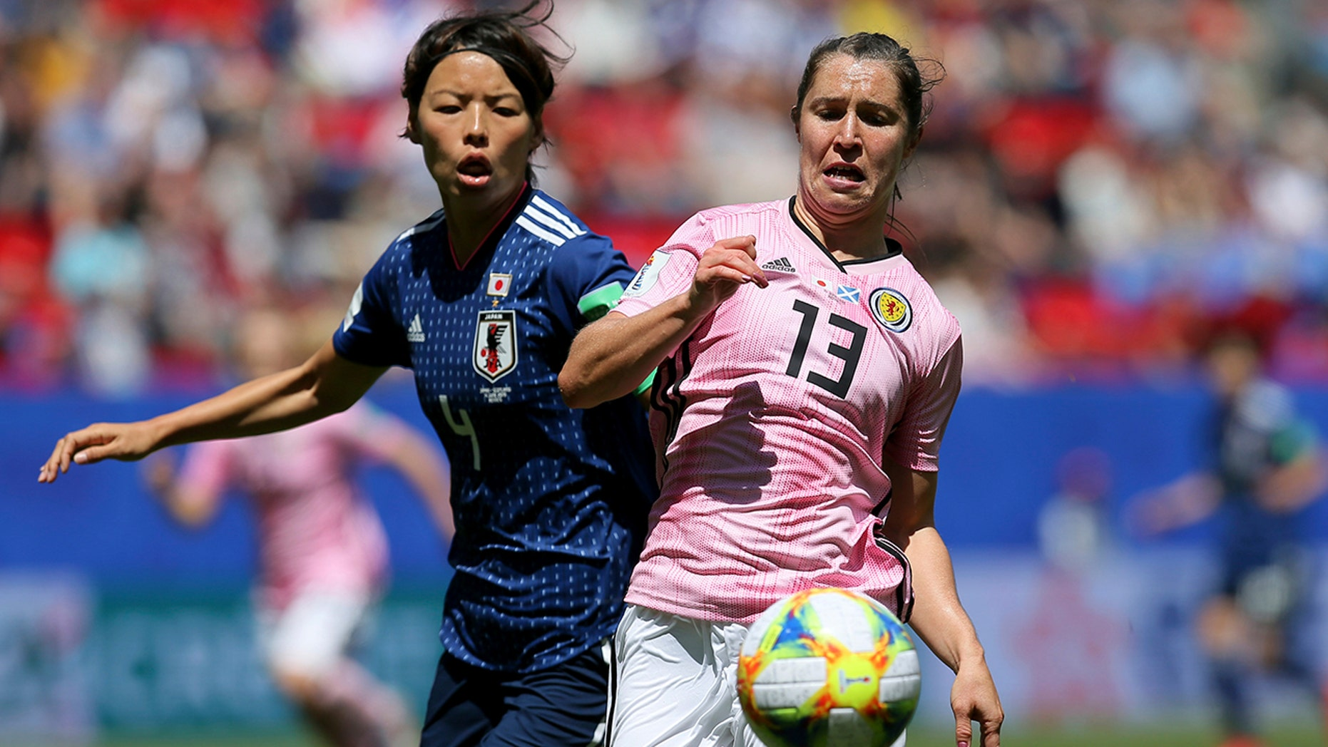 Scotland's Jane Ross, right, is challenged by Japan's Saki Kumagai during the Women's World Cup Group D soccer match between Japan and Scotland at the Roazhon Park in Rennes, France, Friday, June 14, 2019. (AP Photo/David Vincent)