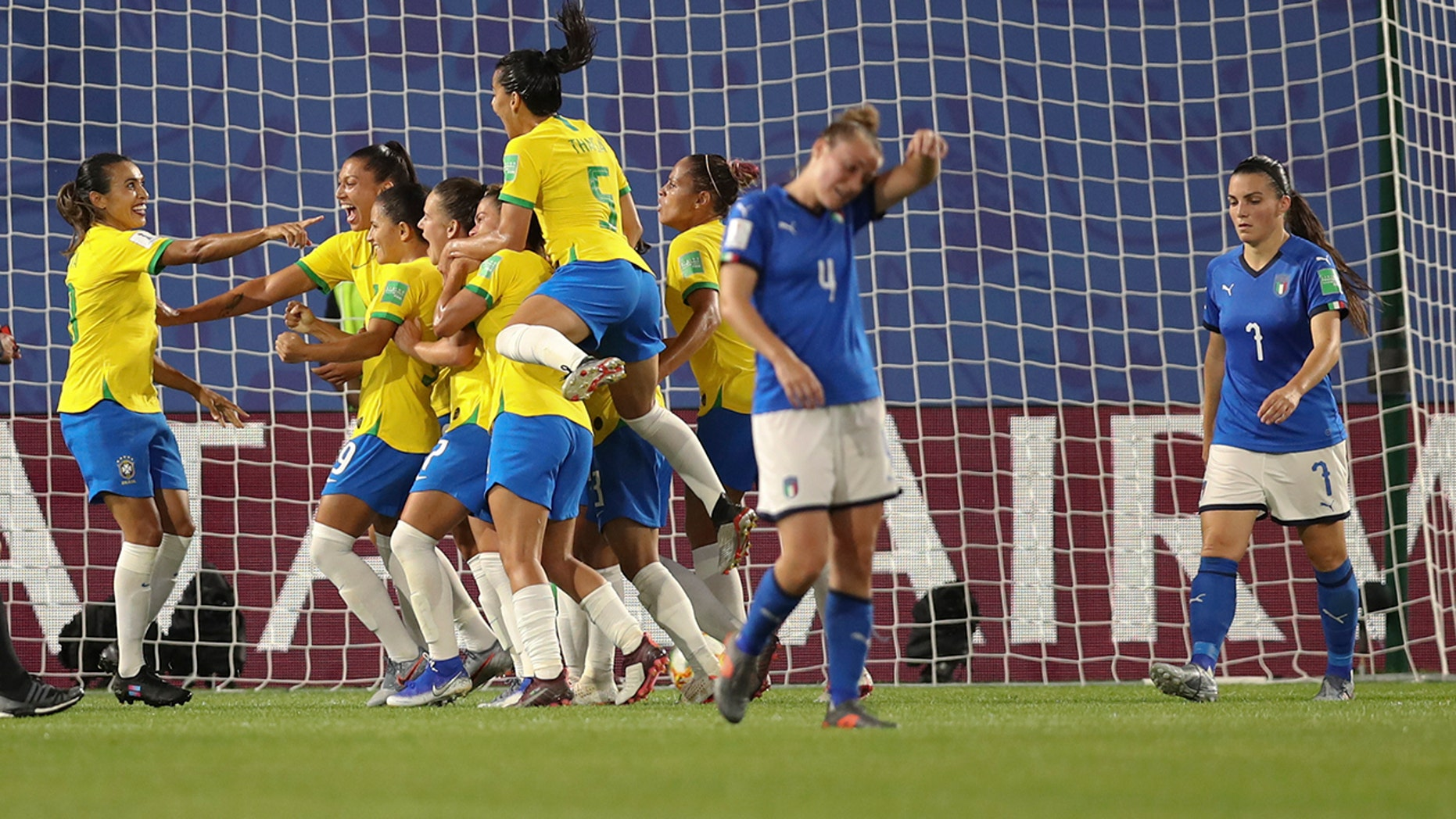 Brazil's Marta, left, celebrates after scoring her side's first goal with a penalty kick during the Women's World Cup Group C soccer match between Italy and Brazil at the Stade du Hainaut in Valenciennes, France, Tuesday, June 18, 2019. (AP Photo/Francisco Seco)