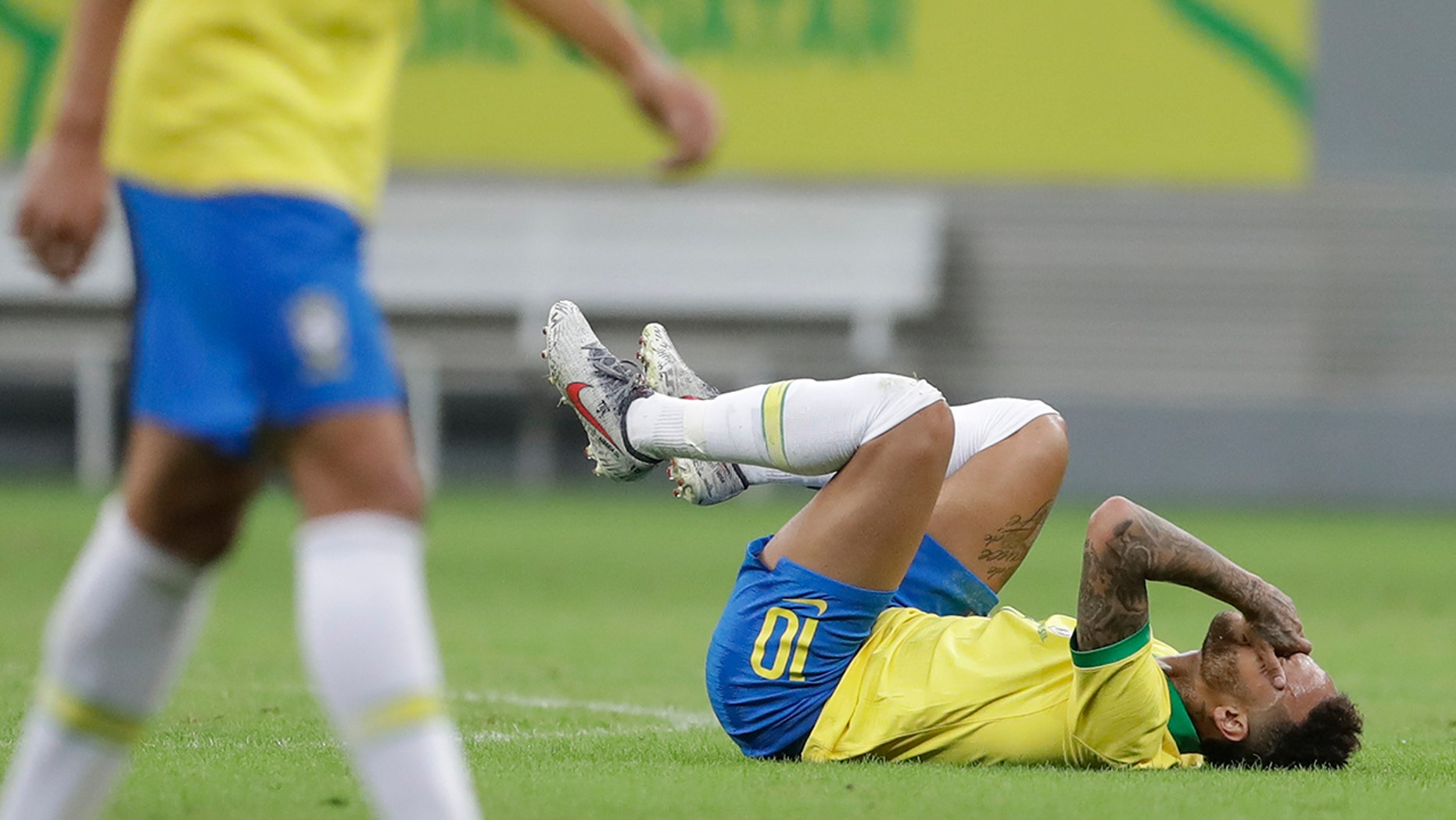 Brazil's Neymar lies on the pitch after being fouled during a friendly soccer match against Qatar at the Estadio Nacional in Brasilia, Brazil, Wednesday, June 5, 2019. Brazil and Qatar are preparing for the Copa America which runs from June 14 until July 7 in Brazil. (AP Photo/Andre Penner)