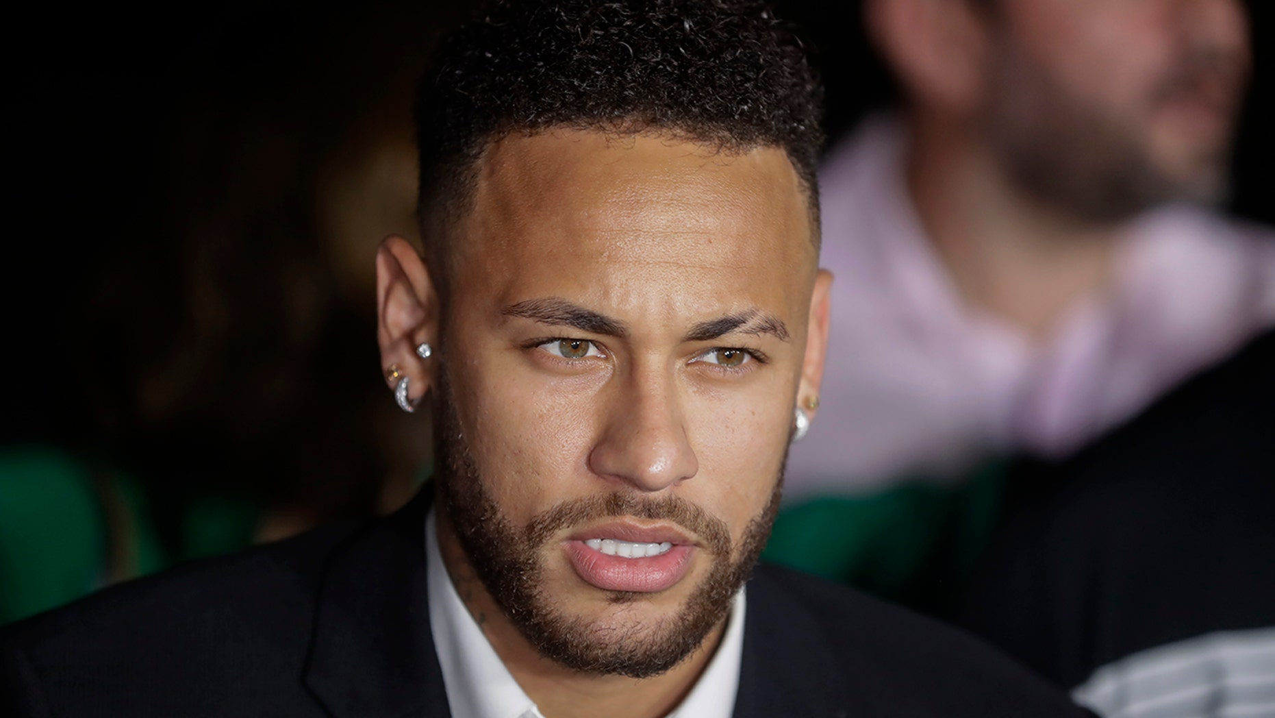 Brazil's soccer player Neymar speaks to the press as he leaves a police station where he answered questions about rape allegations against him in Sao Paulo, Brazil, Thursday, June 13, 2019. Neymar denies any wrongdoing. (AP Photo/Andre Penner)