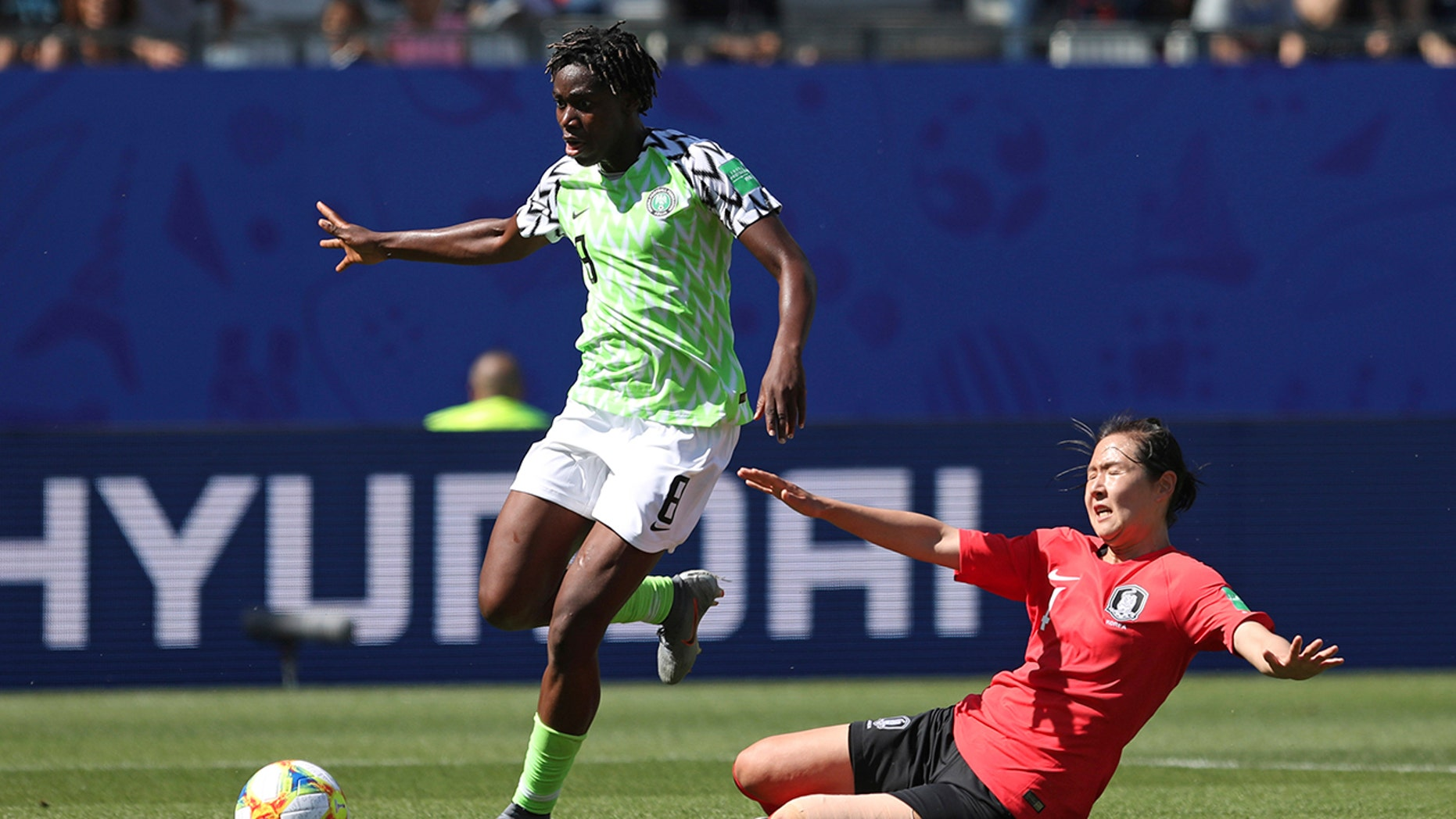 Nigeria's Asisat Oshoala gets away from South Korea's Hwang Bo-ram on her way to scoring her side's second goal during the Women's World Cup Group A soccer match between Nigeria and South Korea in Grenoble, France, Wednesday June 12, 2019.(AP Photo/Laurent Cipriani)