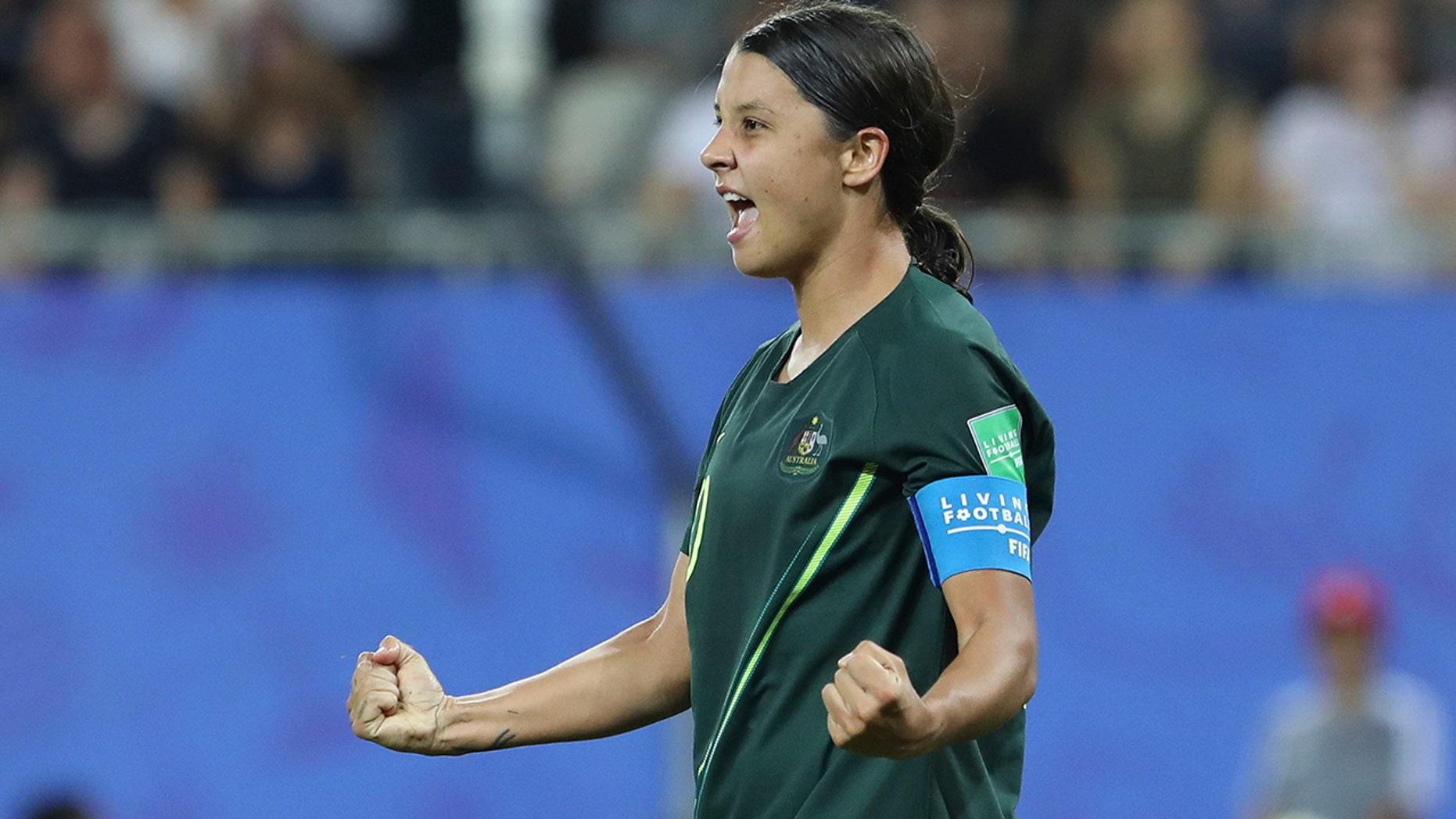 Australia's Sam Kerr celebrates after scoring her side's fourth idea during a Women's World Cup Group C soccer compare between Jamaica and Australia during Stade des Alpes track in Grenoble, France, Tuesday, Jun 18, 2019. (AP Photo/Laurent Cipriani)