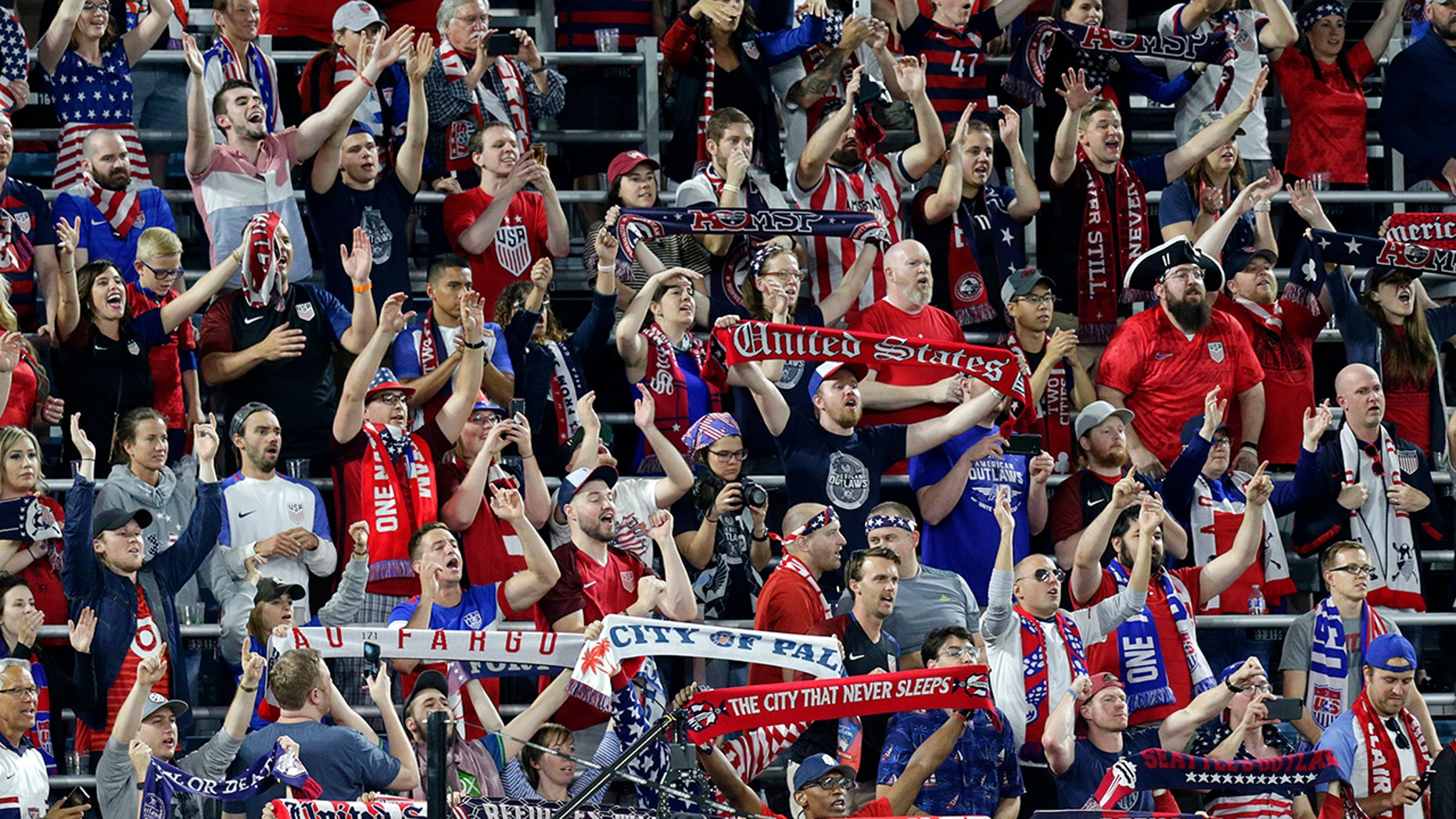U.S. fans cheer during the second half of the team's CONCACAF Gold Cup soccer match against Guyana on Tuesday, June 18, 2019, in St. Paul, Minn. (AP Photo/Andy Clayton-King)