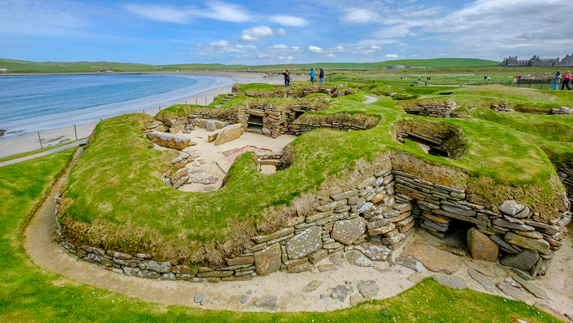 Tourists visiting Skara Brae, a Neolithic allotment located in a Mainland Orkney. In this antiquated village, one of a best recorded groups of antiquated houses in Western Europe, people can see a approach of life of 5,000 years ago, before Stonehenge was built. (Credit: iStock)