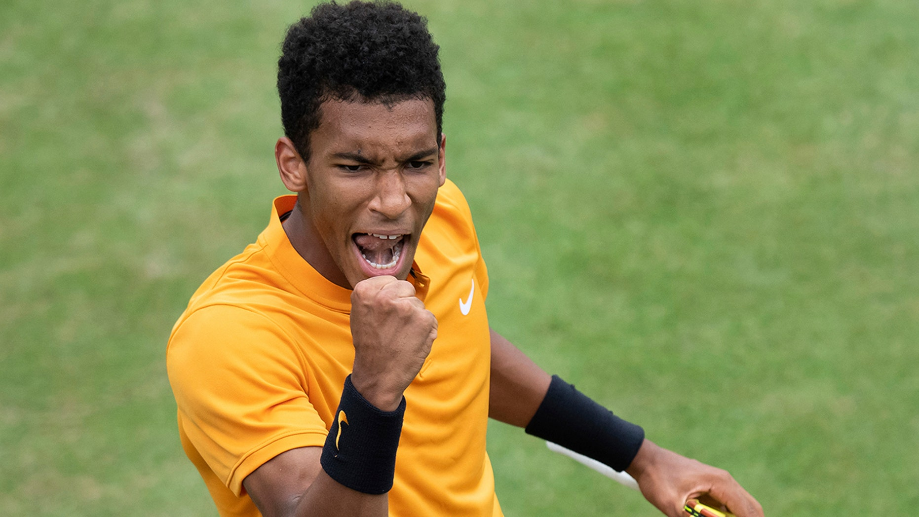 Felix Auger-Aliassime, of Canada, reacts during the quarterfinals of the Stuttgart Open tennis tournament against Dustin Brown of Germany,, Friday, June 14, 2019, in Stuttgart, Germany. Auger-Aliassime won 7-6 (3), 6-7 (2), 7-6 (2). (Silas Stein/dpa via AP)