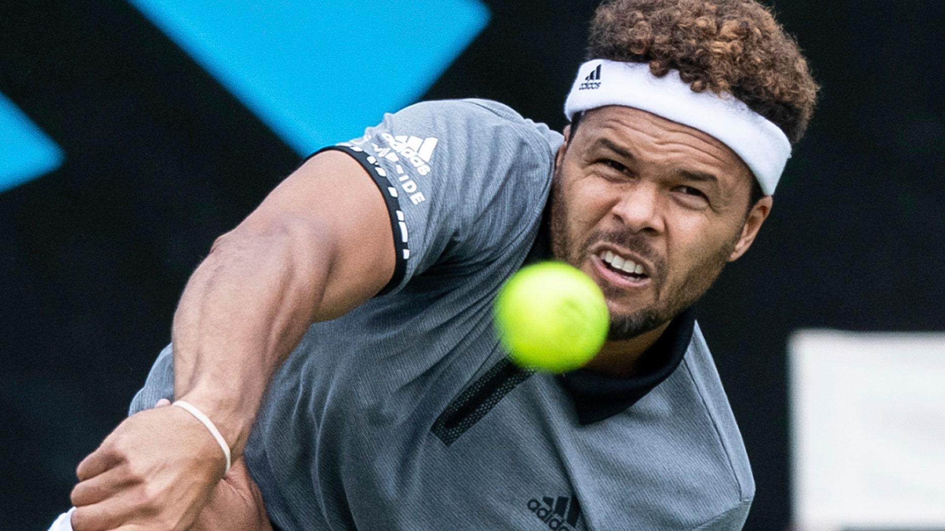 Jo-Wilfried Tsonga serves the ball to Mischa Zverev during their first round match at the ATP tennis tournament in Stuttgart, Germany, Monday, June 10, 2019. (Silas Stein/dpa via AP)