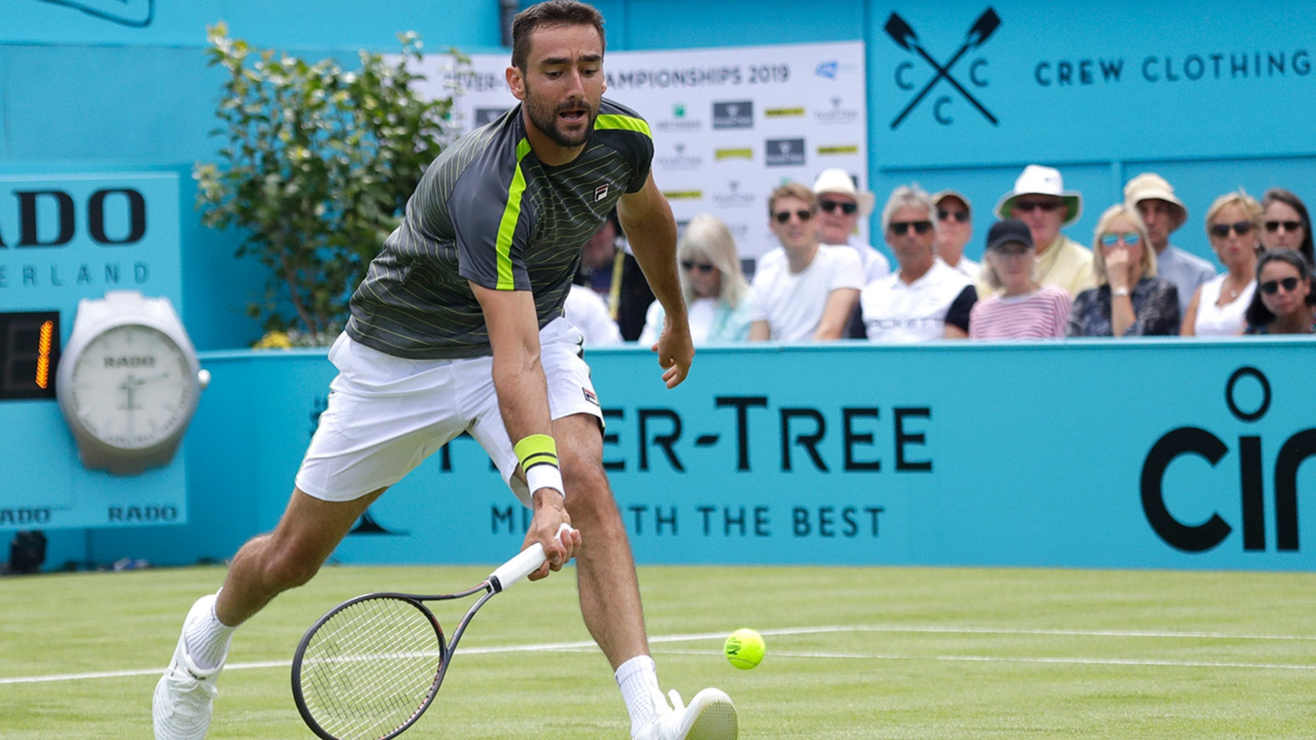Marin Cilic of Croatia plays a return to Cristian Garin of Chile during their singles match at the Queens Club tennis tournment in London, Monday, June 17, 2019. (AP Photo/Kirsty Wigglesworth)