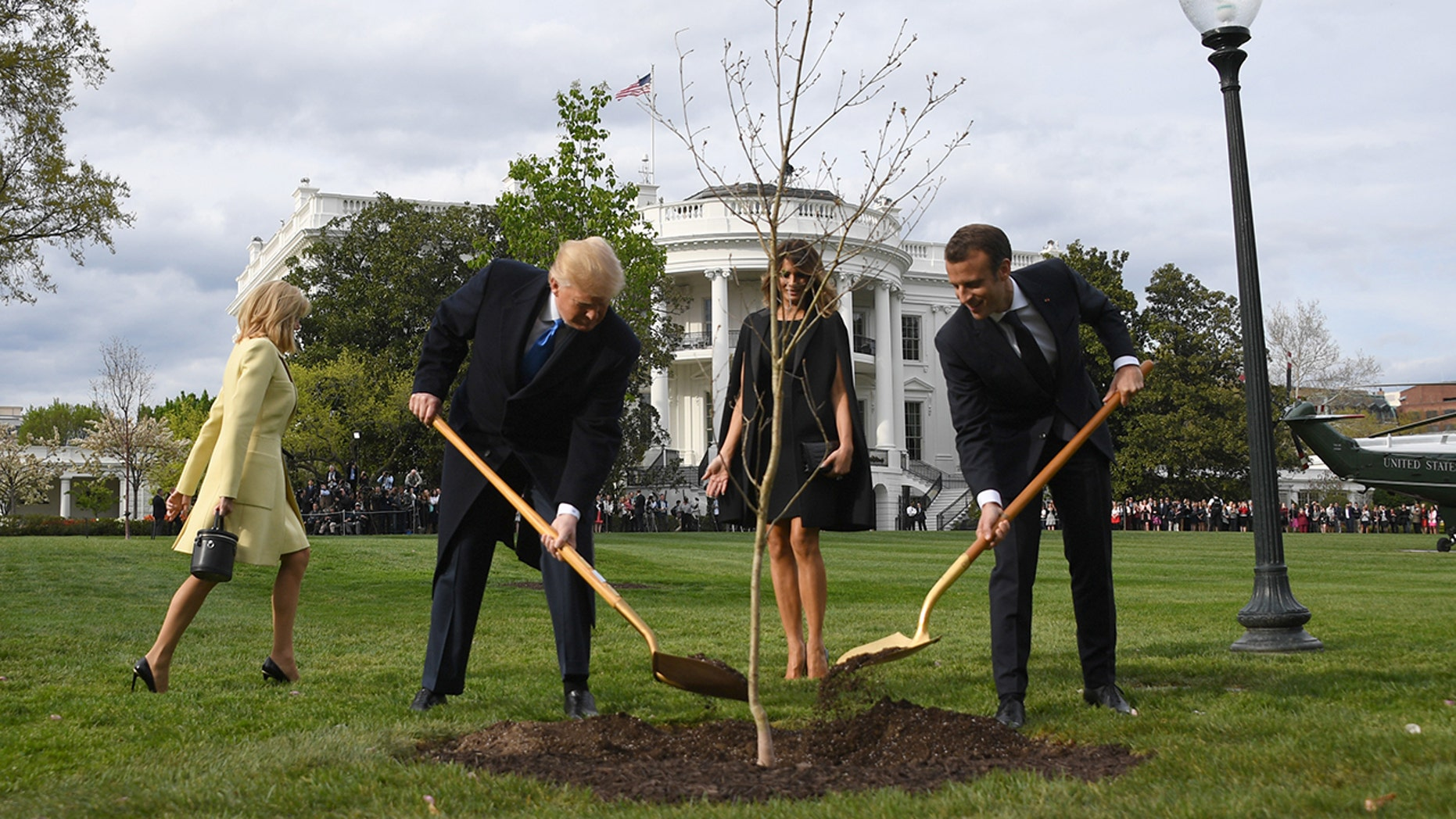 President Trump and first lady Melania Trump participate in a tree planting ceremony with French President Emmanuel Macron and his wife Brigitte Macron on the South Lawn of the White House in Washington, DC, on April 23, 2018. (JIM WATSON/AFP/Getty Images)