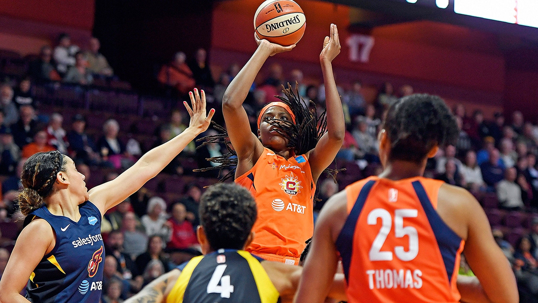 FILE - In this May 28, 2019, record photo, Connecticut Sun core Jonquel Jones shoots over a Indiana Fever invulnerability during a WNBA basketball game, in Uncasville, Conn. Led by Jones, a Sun (8-1) have won their final 6 games and have started to put a small stretch between themselves and a rest of a league. (Sean D. Elliot/The Day around AP, File)