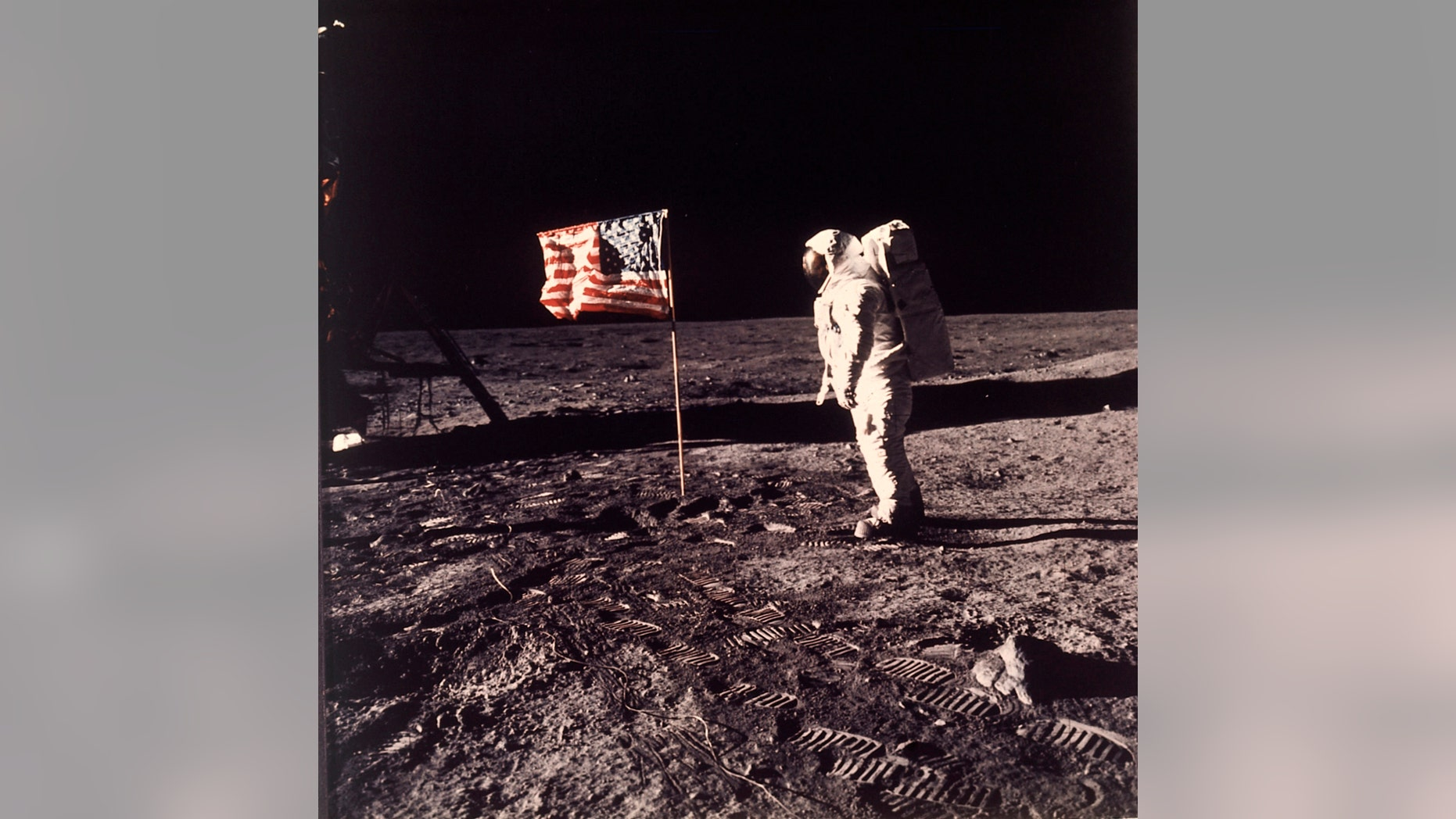 FILE - In this image provided by NASA, astronaut Buzz Aldrin poses for a photograph beside the U.S. flag deployed on the moon during the Apollo 11 mission on July 20, 1969. A new poll shows most Americans prefer focusing on potential asteroid impacts over a return to the moon. The survey by The Associated Press and the NORC Center for Public Affairs Research was released Thursday, June 20, one month before the 50th anniversary of Neil Armstrong and Aldrin's momentous lunar landing. (Neil A. Armstrong/NASA via AP)