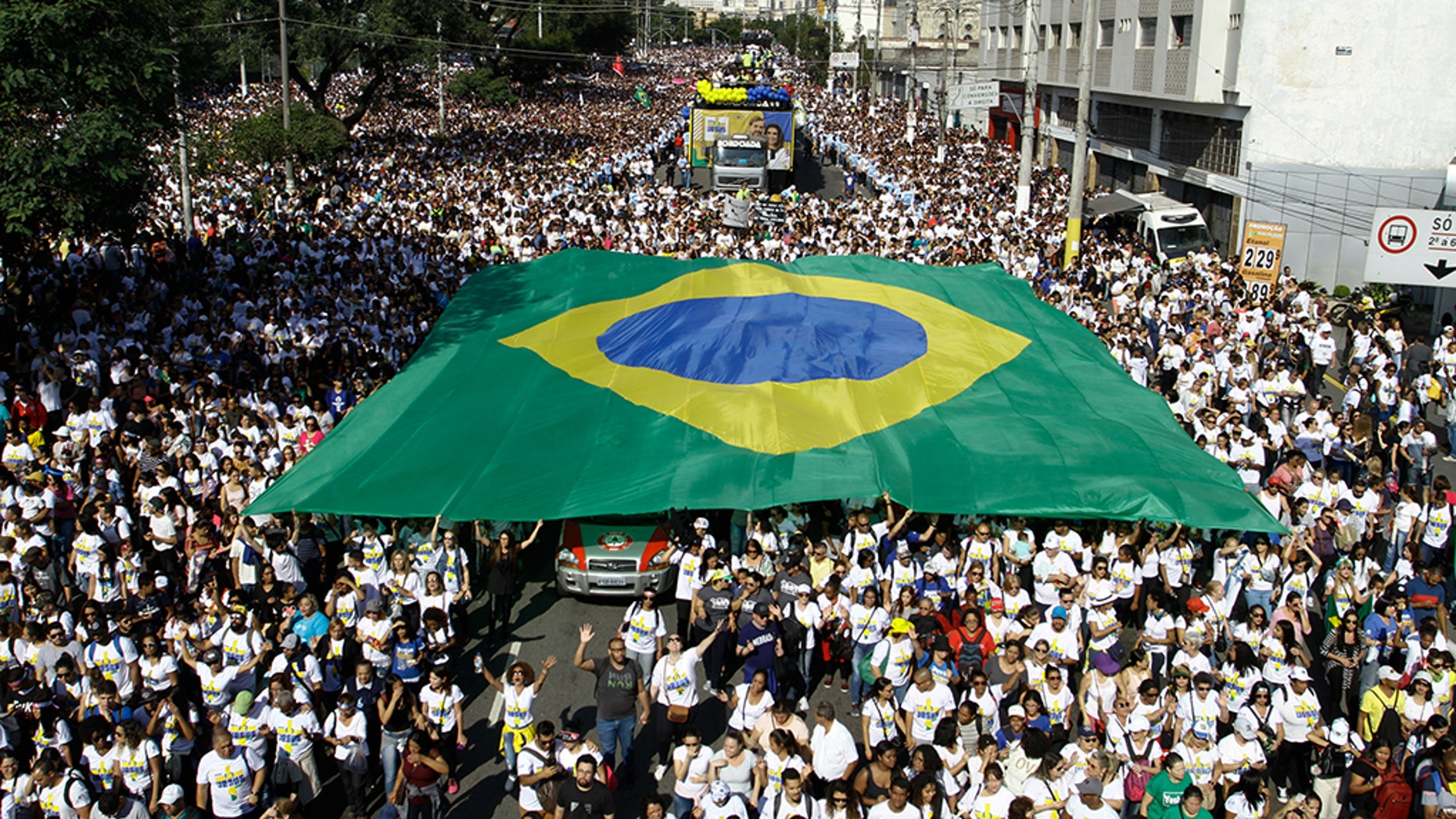 "People take part in the 27th edition of March for Jesus, in Sao Paulo, Brazil, on June 20, 2019. ""March For Jesus"" is the largest evangelical event in Brazil. (Photo by Fabio Vieira/FotoRua/NurPhoto via Getty Images)"