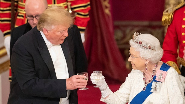 President Trump, left and Queen Elizabeth II toast, during the State Banquet at Buckingham Palace, in London, June 3, 2019. (Dominic Lipinski/Pool Photo via AP)