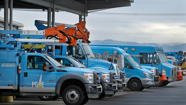 FILE - In this Jan. 14, 2019, file photo, Pacific Gas & Electric vehicles are parked at the PG&E Oakland Service Center in Oakland, Calif. The year's first fire danger warning in Northern California is putting Pacific Gas & Electric on alert. The utility said starting Saturday, June 8, 2019, it might turn off power to thousands of customers in areas north of San Francisco and in the Sierra foothills to help reduce the risk of fire. (AP Photo/Ben Margot, File)