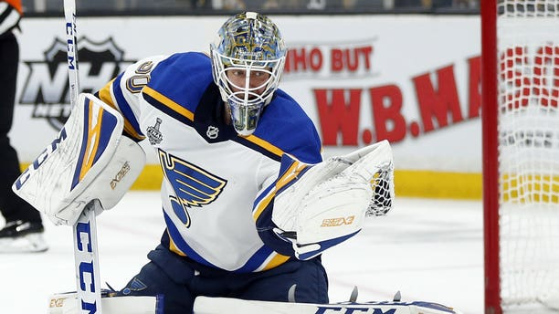 St. Louis Blues goaltender Jordan Binnington catching the puck to make a save against the Boston Bruins during the second period in Game 7 of the NHL's Stanley Cup Final on Wednesday in Boston. (AP Photo/Michael Dwyer)