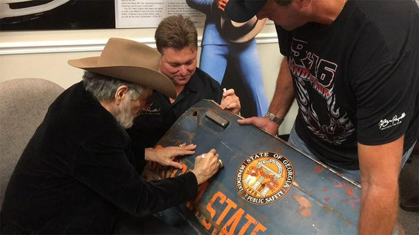 Gene Kennedy (upper left) said Burt Reynolds remained devoted to his fans over the years. — Courtesy of Gene Kennedy