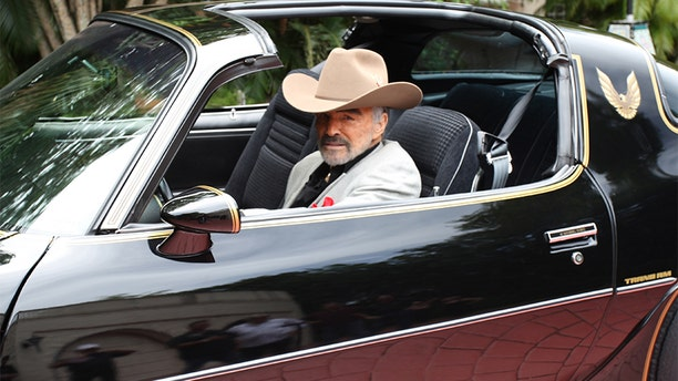 """Burt Reynolds was proud of his """"Smokey and the Bandit"""" legacy. — Julien's Auctions"""